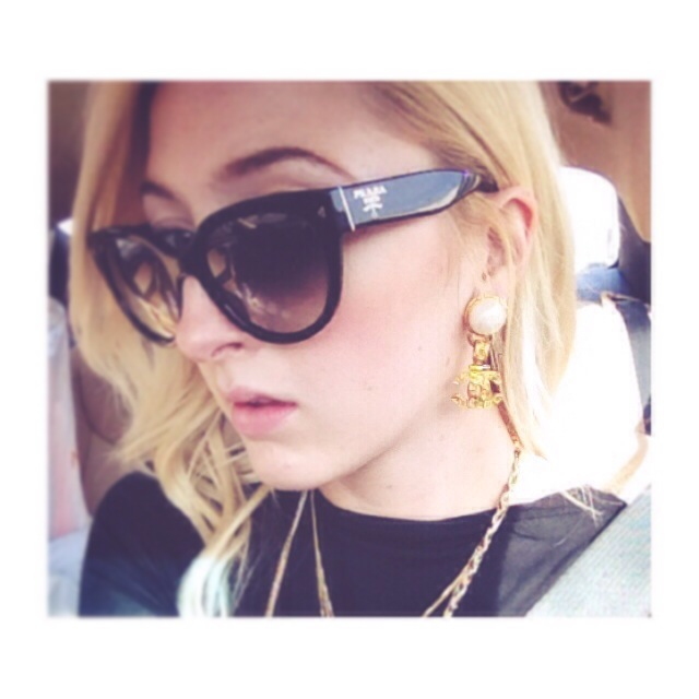 Every girl loves her accessories, like Prada sunnies and vintage Chanel earrings