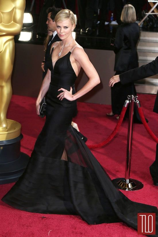 Charlize, Charlize, Charlize! I die for this illusion Dior gown.