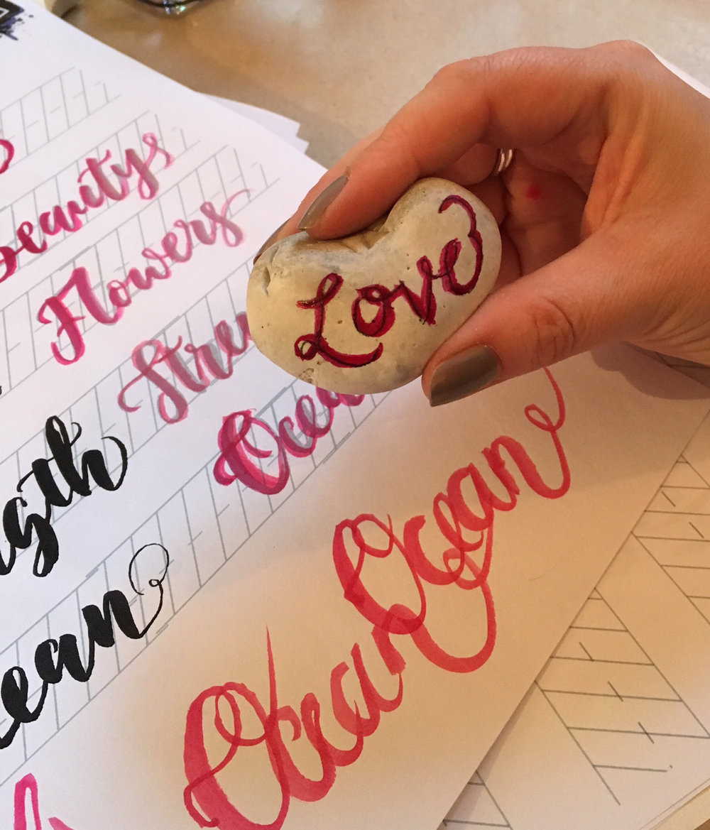 Some fun brush letterings into a heart shaped stone.
