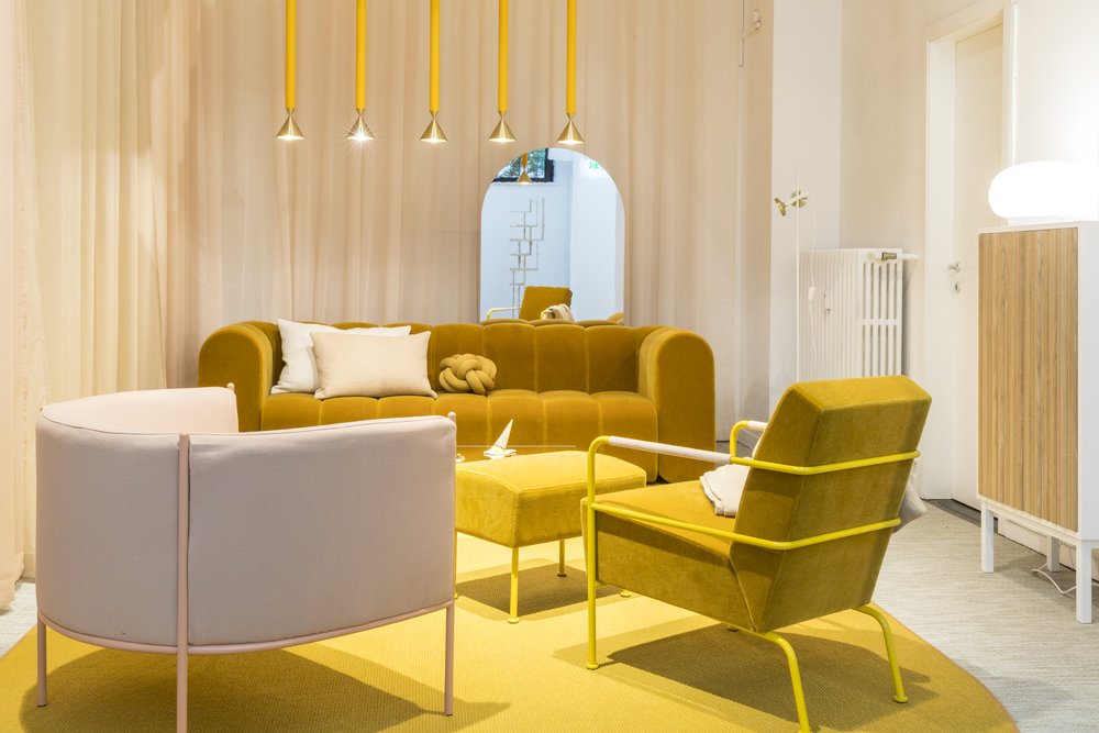 Mustard-accented installation called Hemma, from the Swedish company Svenksform.
