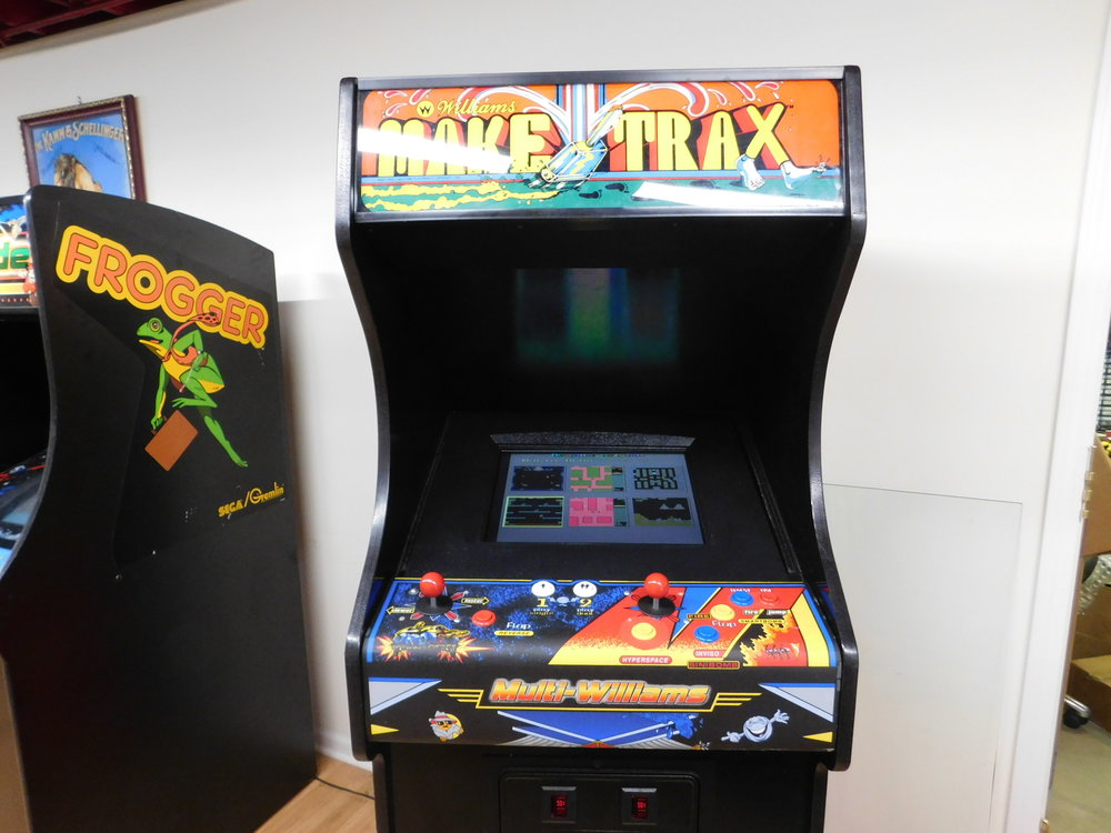 This Williams Multi Game Arcade Features A Classic Make Traxx Cabinet In  Excellent Condition! All Electronics Have Been Updated As Well.
