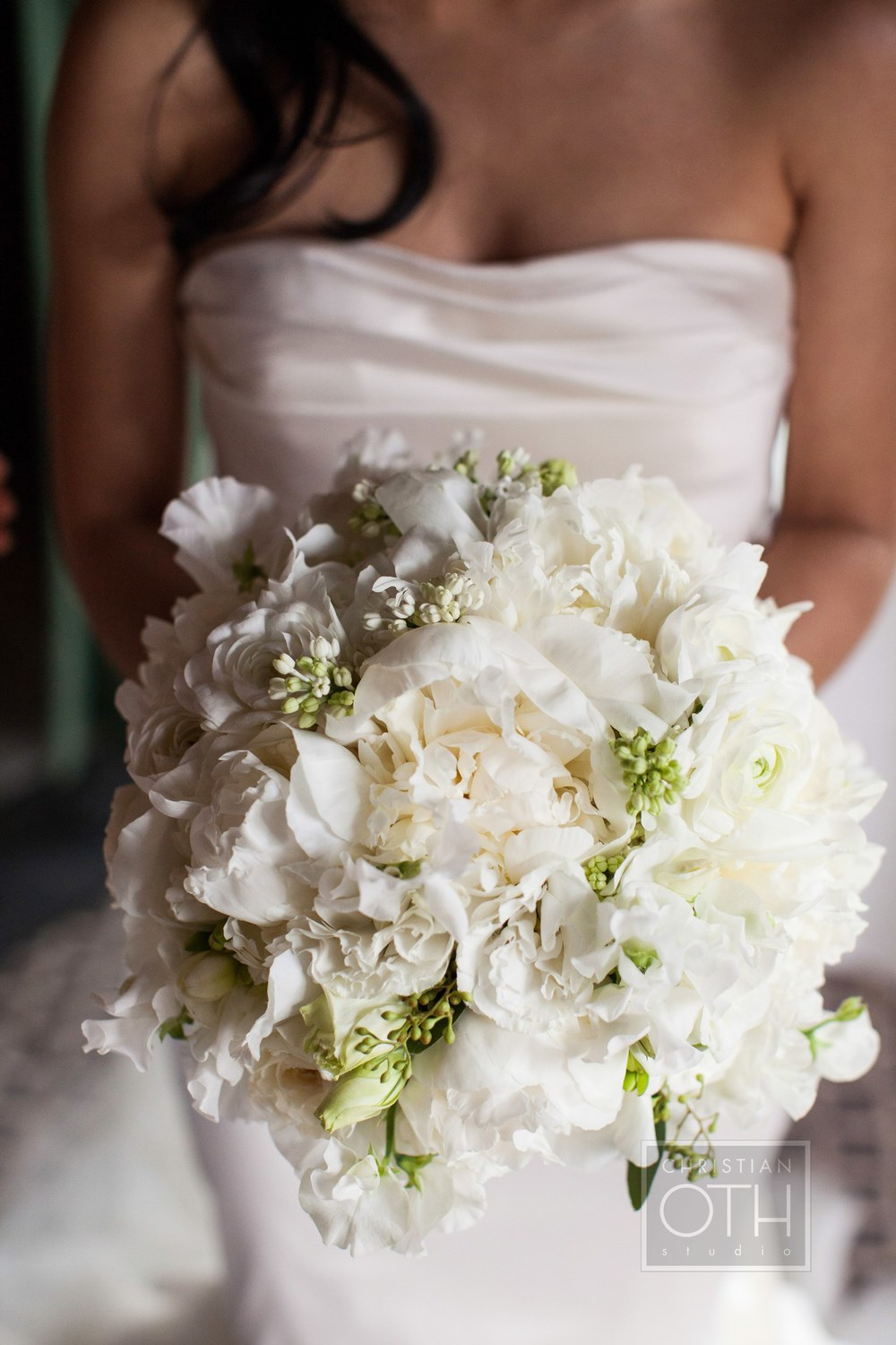 All white bouquet by Belle Fleur photographed by Christian Oth Studios.