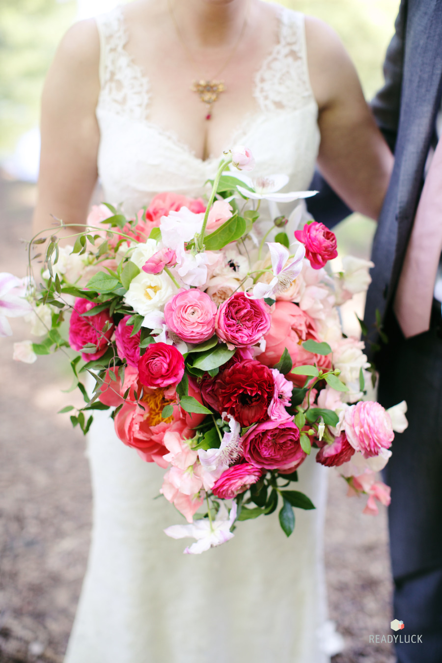 Vibrant bridal bouquet by Poppies and Posies. Photo by Readyluck.