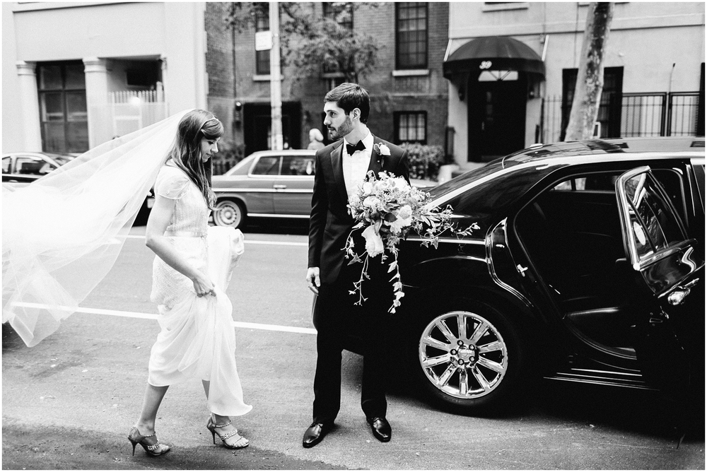 Annie and Manuel make their way to their reception in their luxury black town car. Photo by Brookelyn Photography.