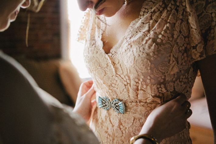 Love the turquoise detail on this vintage wedding dress! Photo by Shannen Natasha.