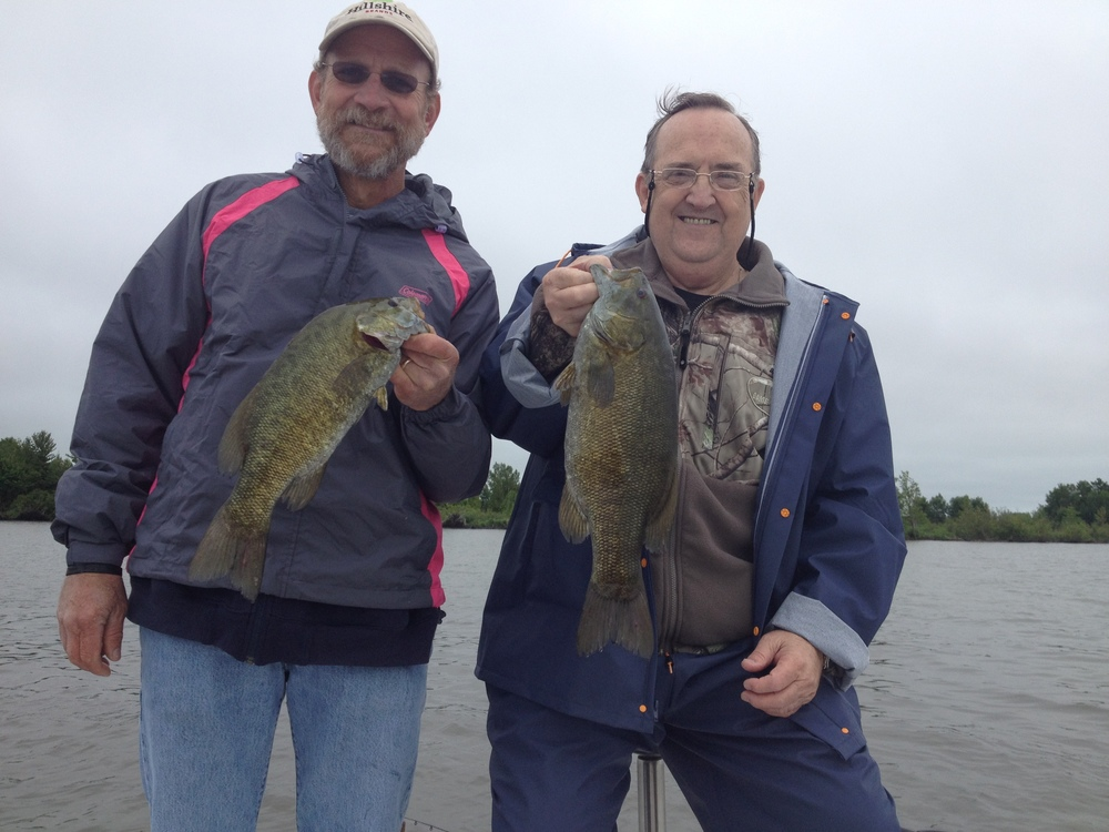 Gary (right) drove his RV all the way from Oklahoma to fish Chequamegon Bay. He has fished Largemouth Bass his entire life, but had never fished for or caught a Smallmouth Bass. He and his brother-in-law Cuck (left) had a great day and I think it's safe to say Gary is hooked on these fish.