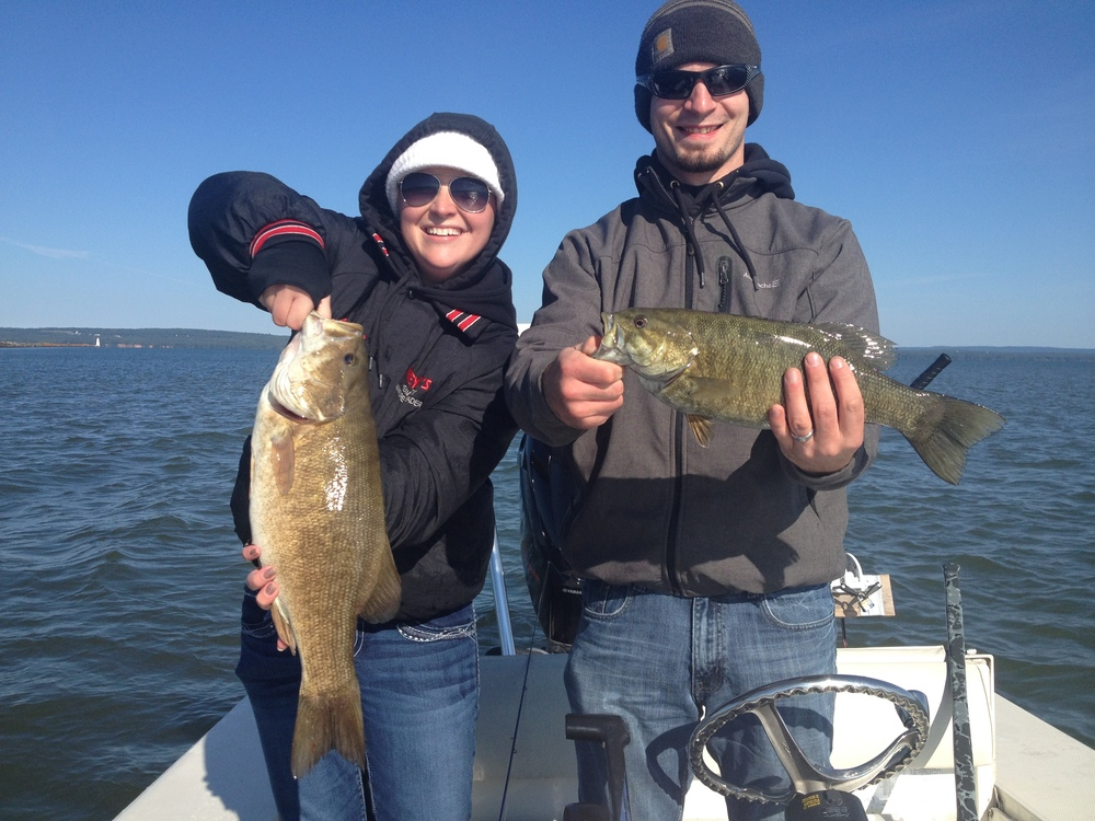 Ashley and Dan came up to Ashland to celebrate their 1st wedding anniversary and had a great day out on Chequamegon Bay.  Sorry Dan, but I think Ashley's fish was a little bigger.....