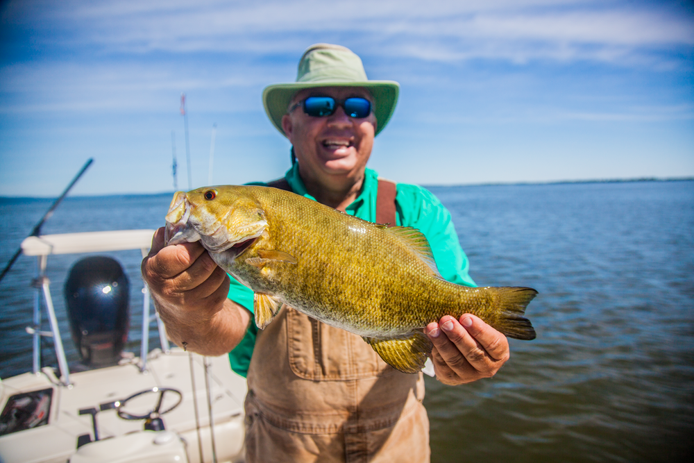 Benny from Arkansas with a nice Bay smallie.  We had to keep moving around this day to find the fish, but the action was steady and the weather was great.