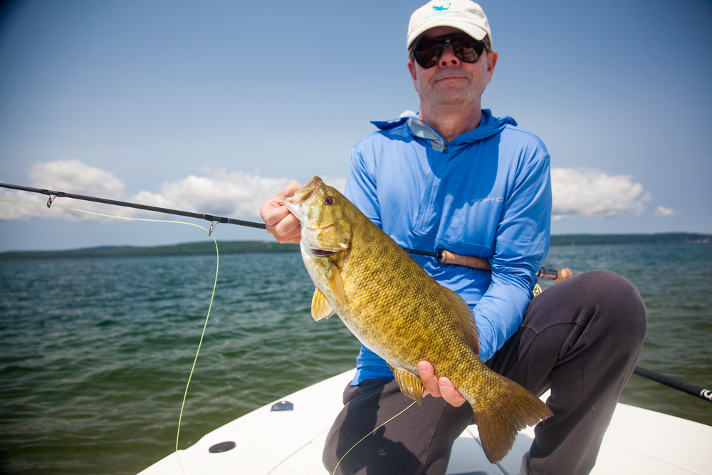 Ron from New York spent 6 days on the Bay chasing smallies on the fly.  We had a great time, experienced all kinds of weather and got into some great fish.