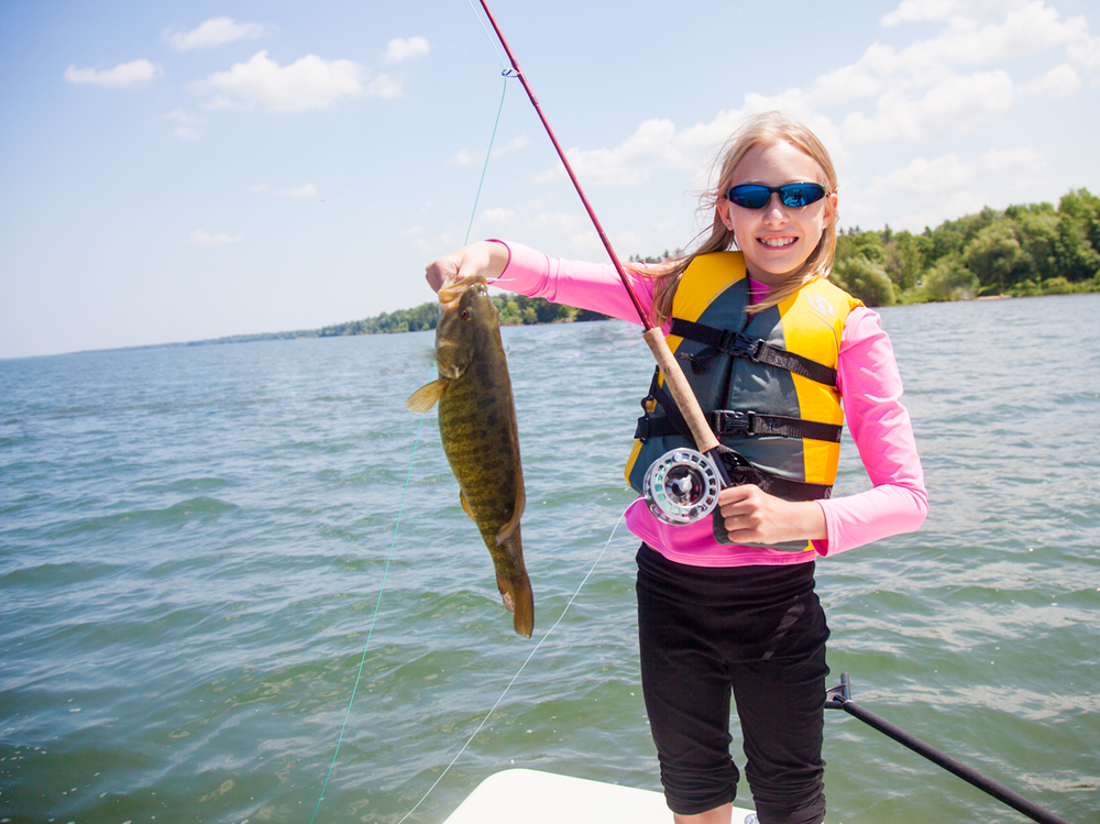 Claire, age 11, from Chicago with her first fish on a fly rod.  Way to go Claire!