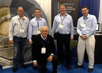 Back Row: UK Distributor Glenn Burbridge, ecoFinish founder Joe Solana lll, ecoFinish Canada Mike Cleary and ecoFinish USA Sales Ed Simmons  Joe Solana Sr. Founder of Carlton Pools center front.