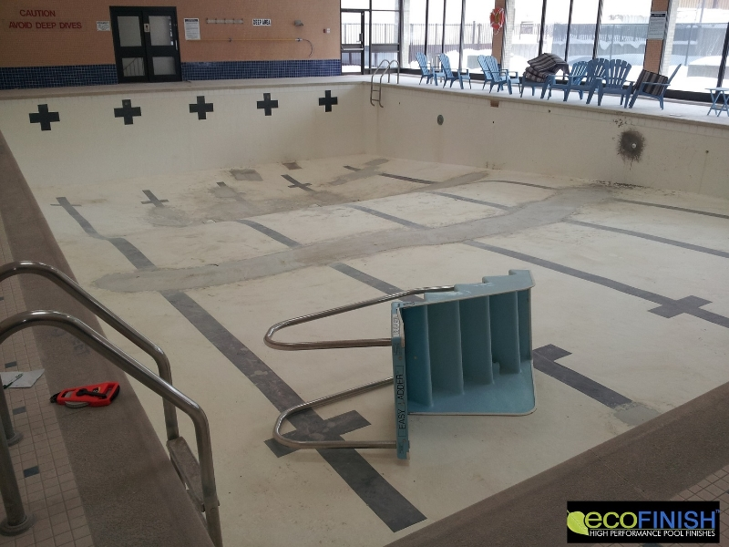 BEFORE PHOTO depicting repaired areas to pool surface prior to surface renovation with ecoFinish