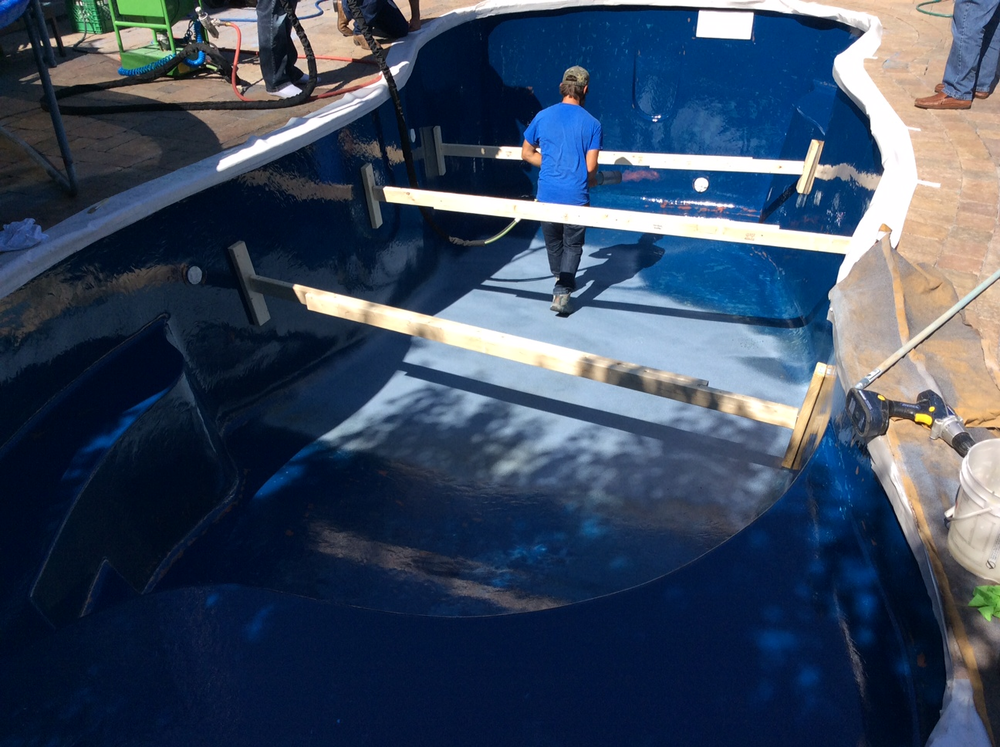 Fiberglass pool shell is braced during renovation to support the walls when water was removed