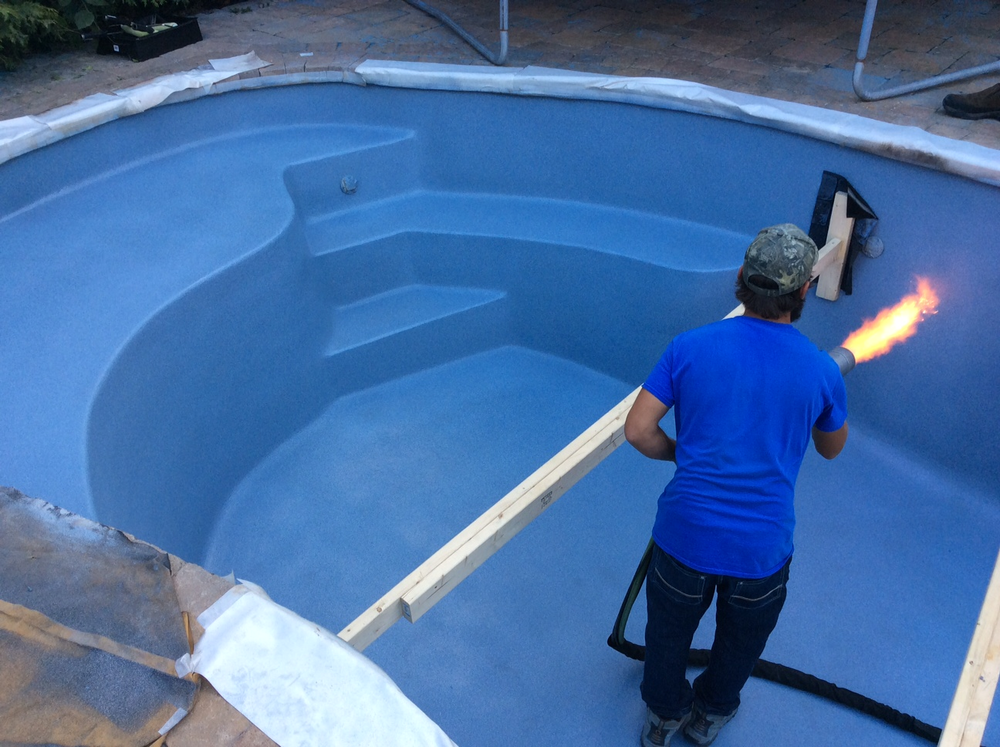 Fiberglass Pool Shell braces are moved to ensure complete finish overall