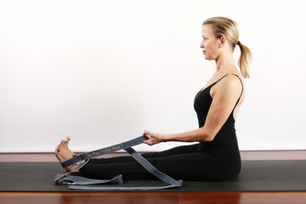 "Place one stationary loop on the sole of your foot (pada) and the other in your 2-finger hold (hand-hasta). This allows you to use your abdominal's (core power) and biceps to enter any pose without tension or holding on for"" dear life"". Now you are entering the next phase of deepening a pose with ease and stability."