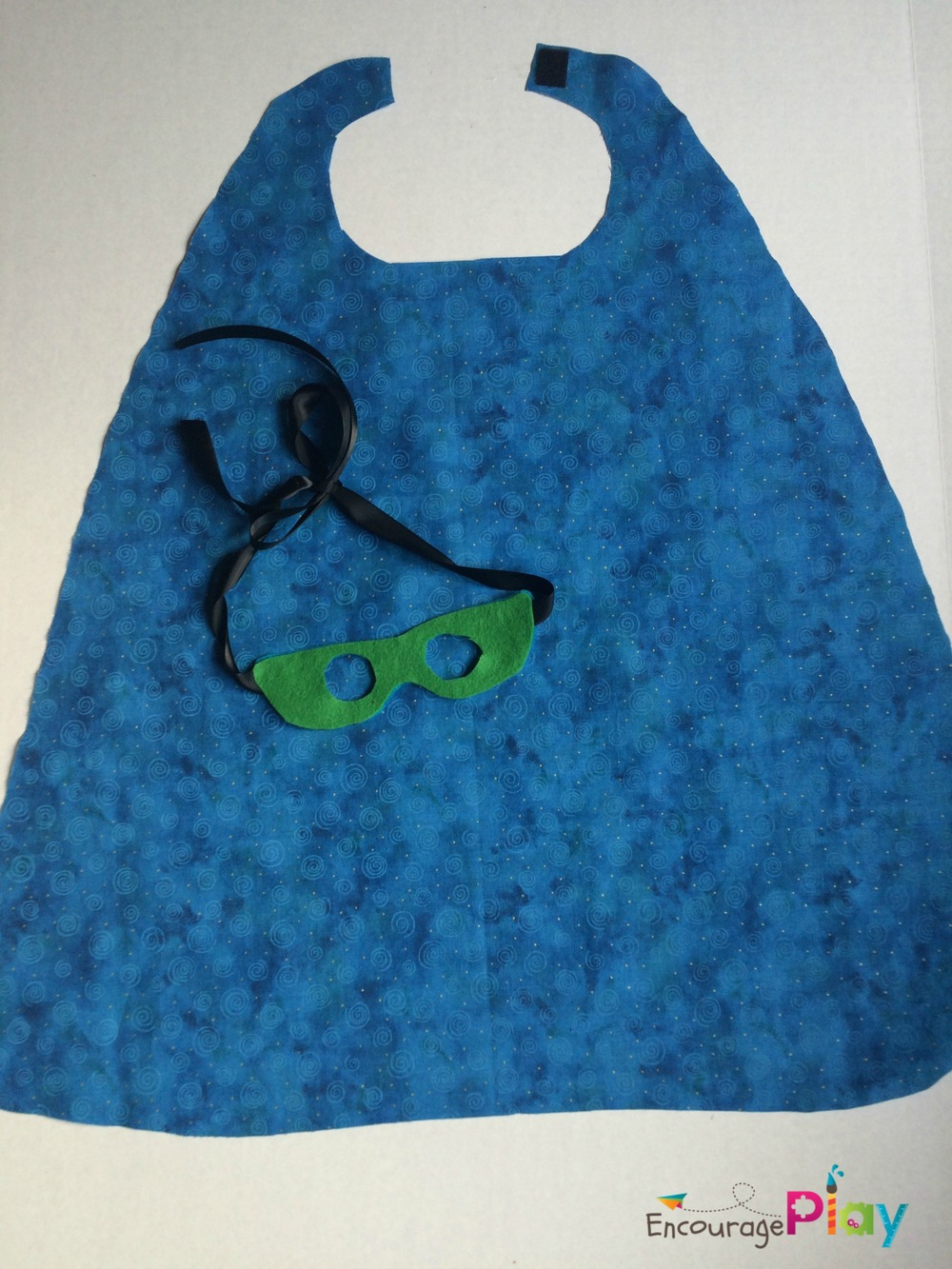 blue cape and green mask by Encourage Play