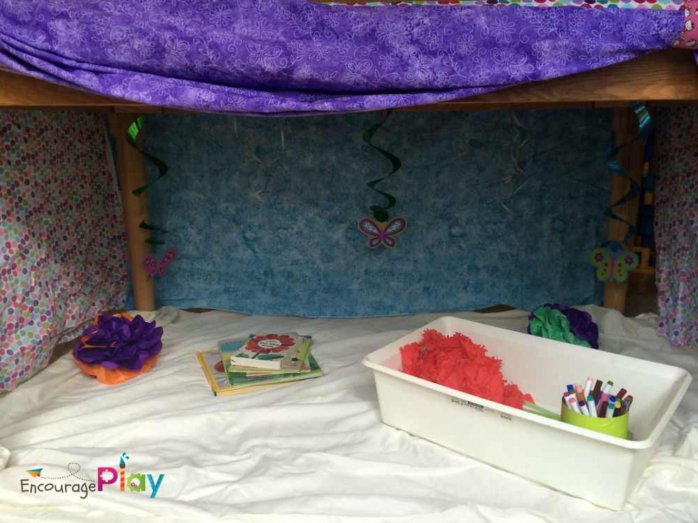 Under the table fort set up by Encourage Play
