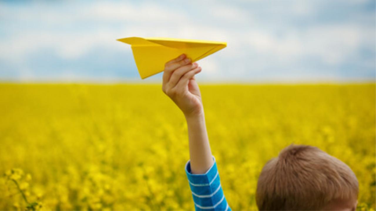 Book kids paper airplane