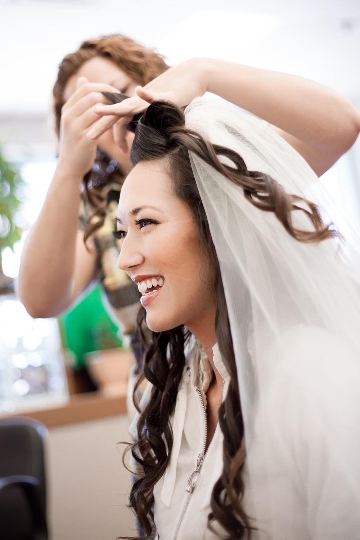 wedding bride preparations putting on veil hair