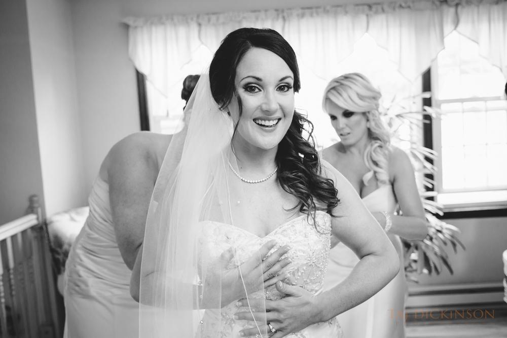 bride preparations putting on dress