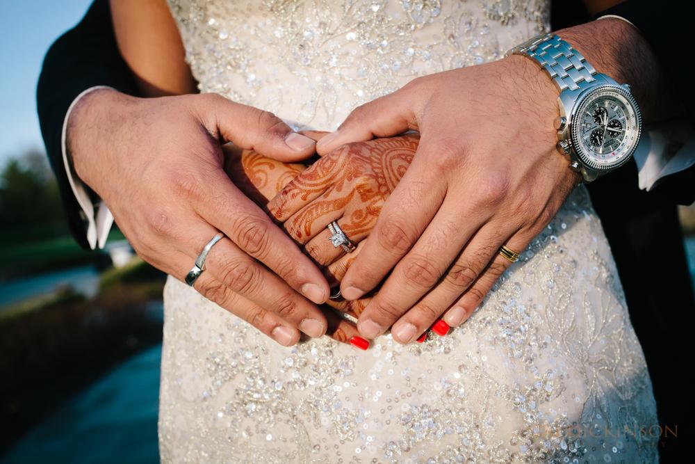 wedding bride groom hand rings henna detail macro closeup