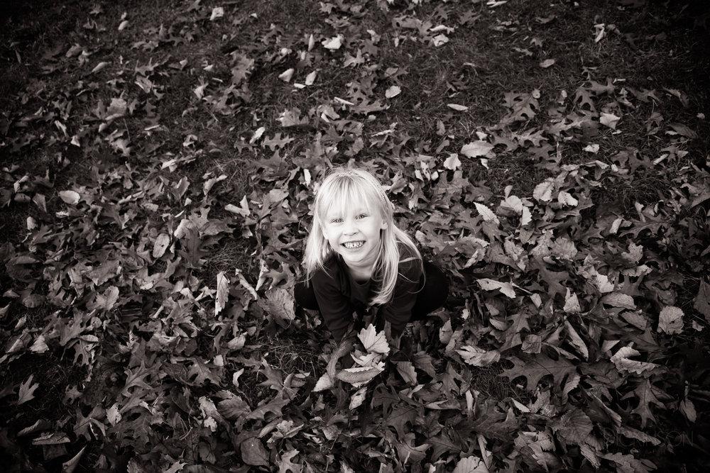 child portrait outdoors leaves