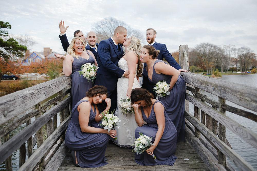 wedding party portrait group shot fun diving park spring lake nj wooden bridge