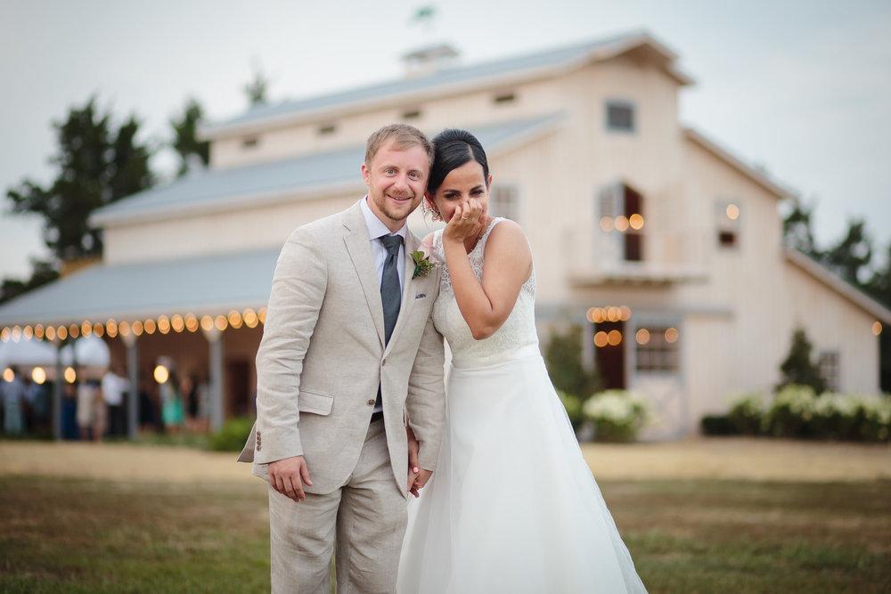 wedding portrait bride groom laugh edel haus alpaca farm wall nj