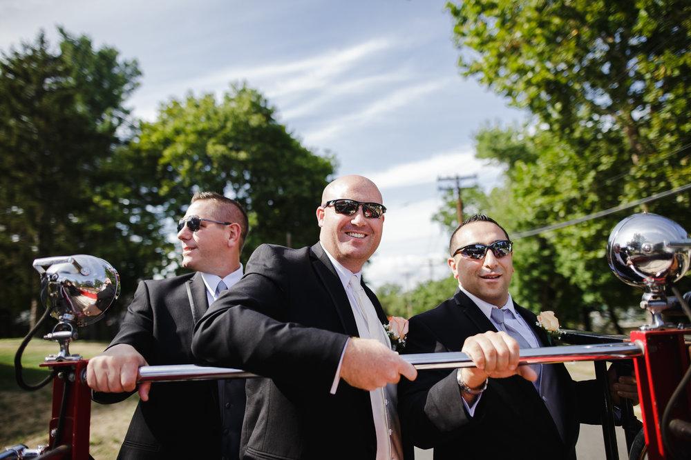 wedding groom grooms men portrait group shot fire truck