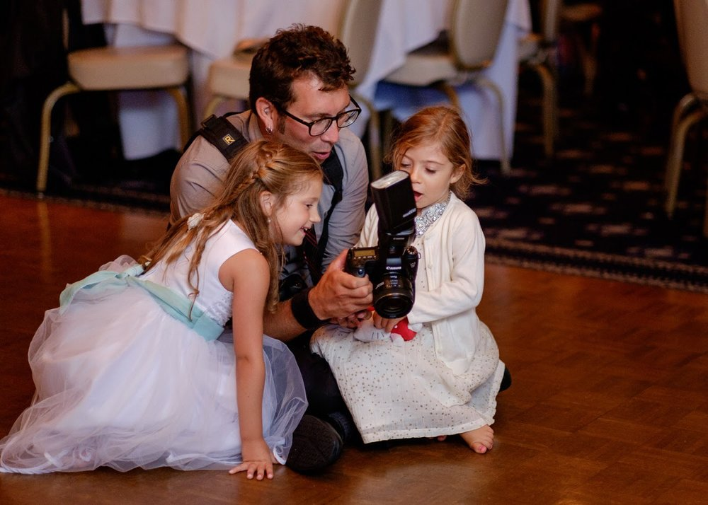 Educating the guests of the techniques of wedding day photography!