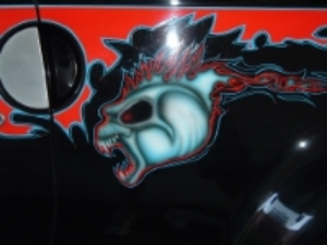 Custom work on my Chevy SSR using airbrush and pinstripe work.