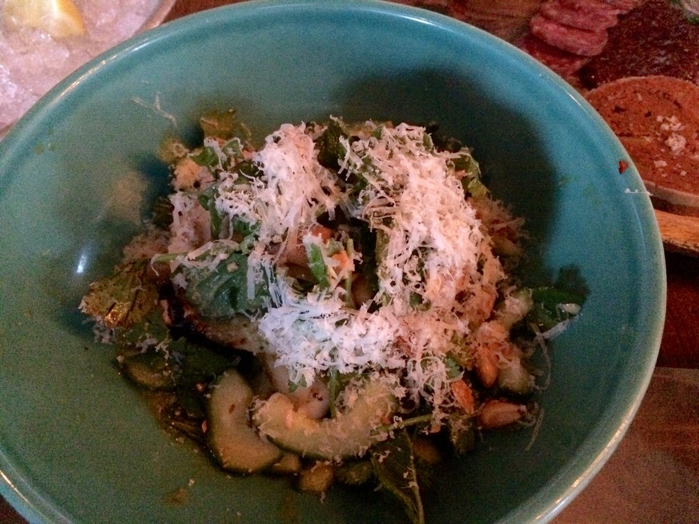 Blood sausage, squid, green chili dressing served over veggies with parmesan and macron almonds.