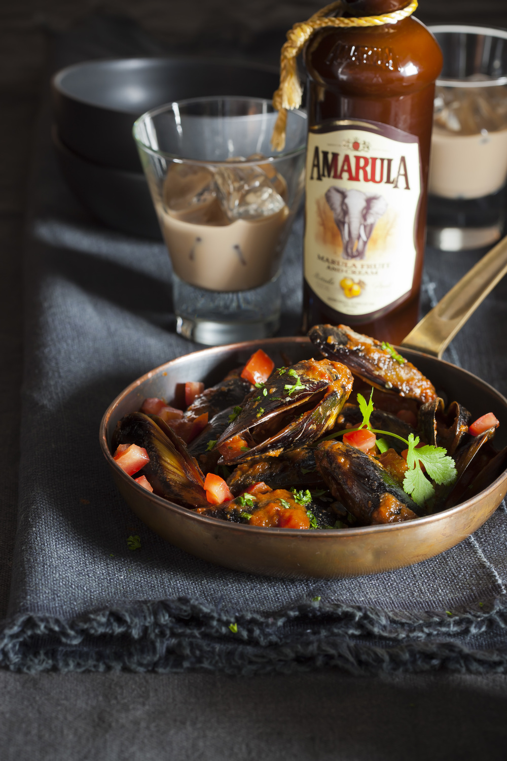 Creole spiced Amarula and mussel chowder with bottle HR.jpg