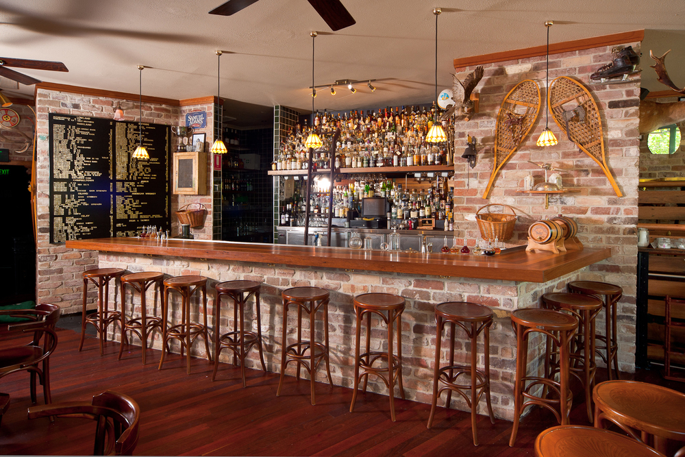 Bar top made from Spotted Gum floor boards recycled from the Bicentennial Basketball Stadium Penrith.  Check out the whiskey collection in the back bar!