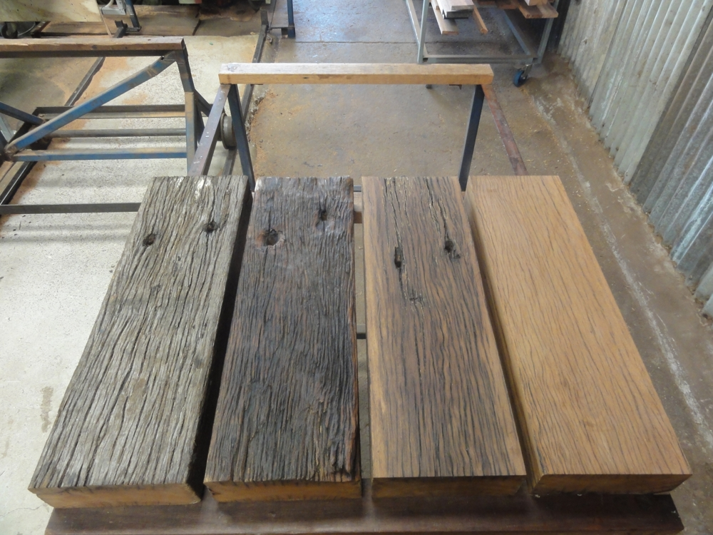 Tallowwood and Blackbutt wharf decking boards at four different levels of processing