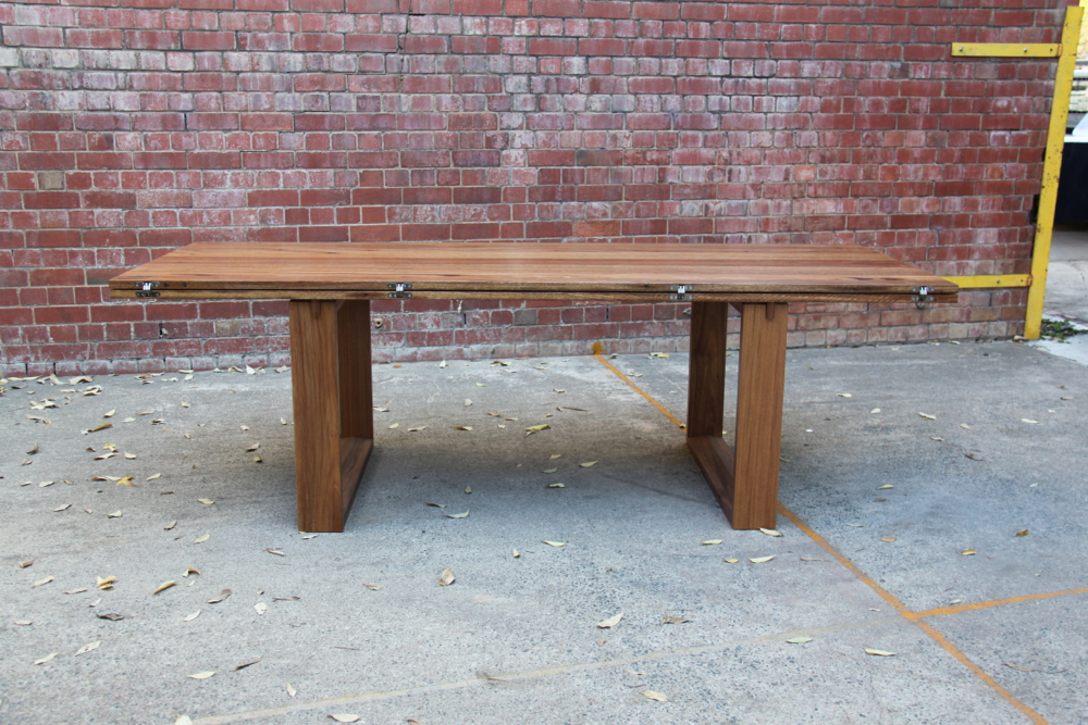 Folding leaf table custom built for Amelia Witheridge folded into it's smallest formation. Seating for 8 people.