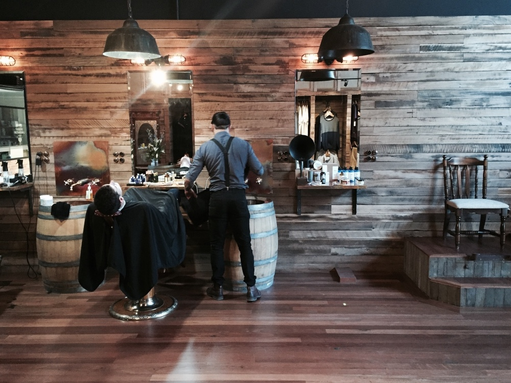 Salvaged timber floor boards and cladding at Groomed Barber Shop, Braddon, ACT.