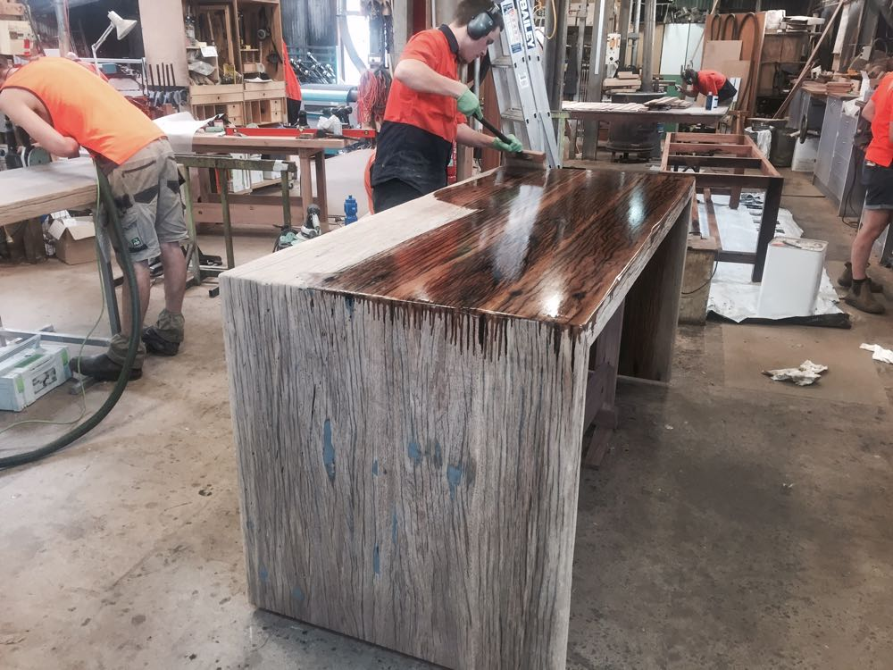 The Kitchen waterfall island bench being finished in Osmo Hard Wax Oil. Osmo is made from plant oils and waxes and is food safe.  It brings out the colour and grain of the timber with a very natural appearance.
