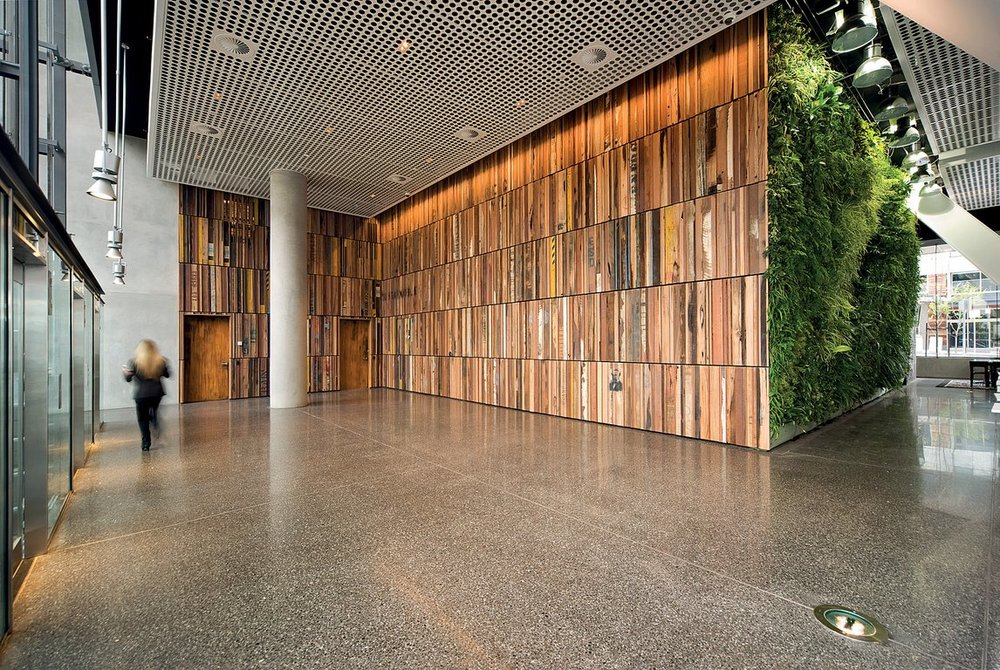 Great use of salvaged timber cladding in a corporate foyer space.