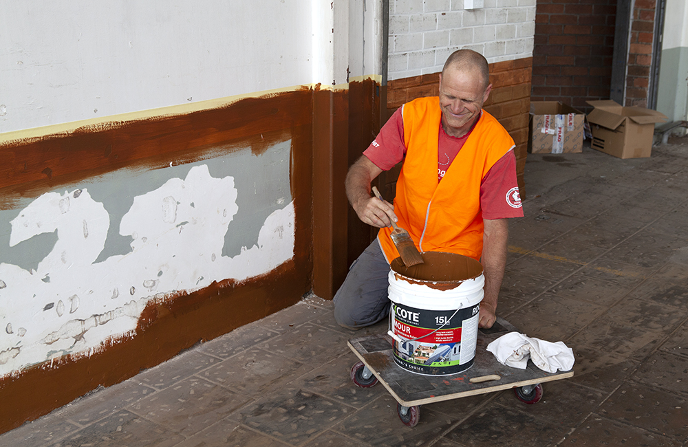 Billy painting over the old paint