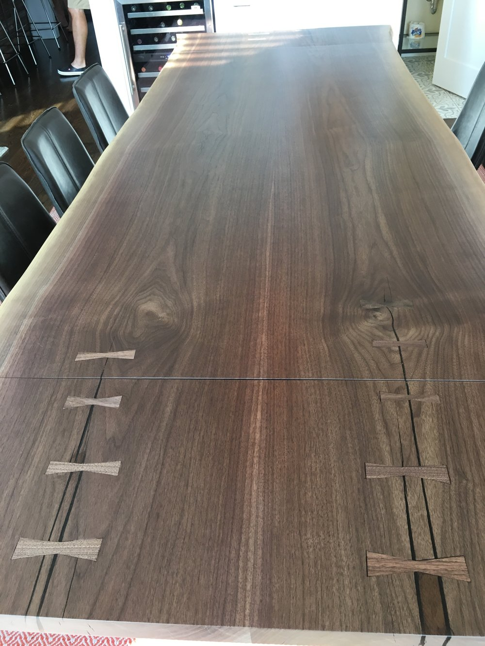 Bowties, fills, and add ons  - We only put bowties where they need to be. These are structural and are crucial in maintaining the integrity of the slabs. We always epoxy voids in the tables so nothing finds its way in and can't get out. Company Boards - We offer custom table extensions for when you have those family get togethers and need a little more space. These are stored in a closet when not being used, and put in when the Turkeys ready!