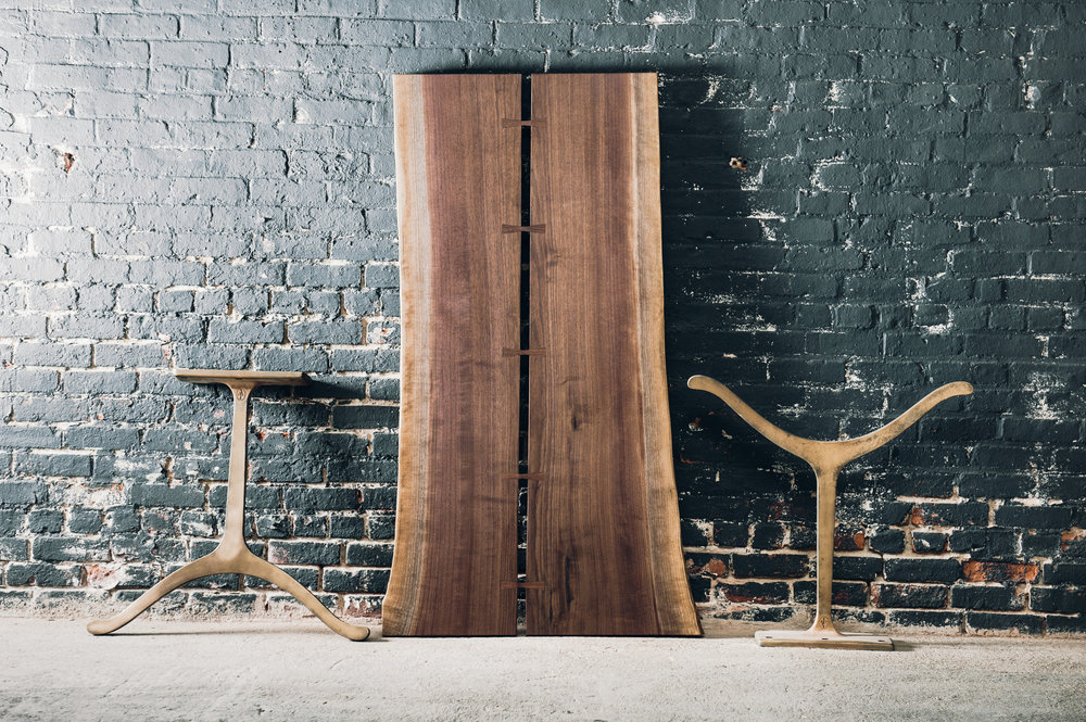5' black walnut pith table with butterfly joints and cast iron legs -