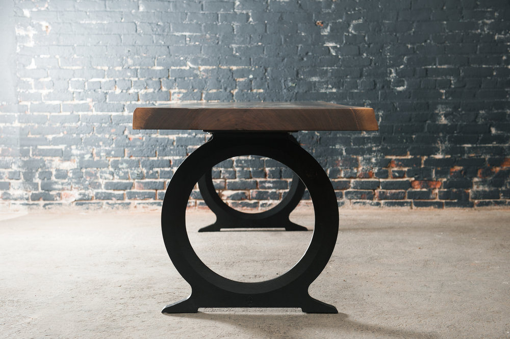 Black walnut slab table with cast iron base