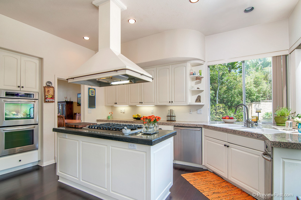 29- Low Res - Kitchen island with orange rug at right at angle.jpg