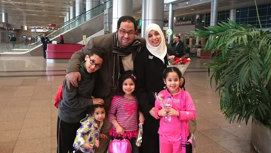 Khaled greets his wife Sarah and their kids at the the airport in Cairo.