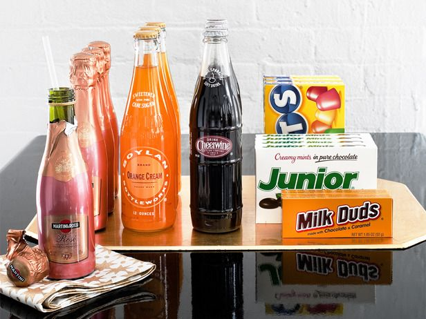 Have some sodas (or individual bottles of champagne) with cute straws and some of your favorite movie candies like Junior Mints and Milk Duds! You can pick your favorites or color coordinate your selections.