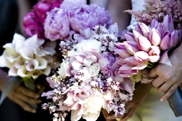 We love the picture of the bridal bouqet of various types of pink flowers and then each bridesmaid has a single variety of flower for her bouquet. What a great explosion of pink flowers! To see more of this wedding, please click  here .