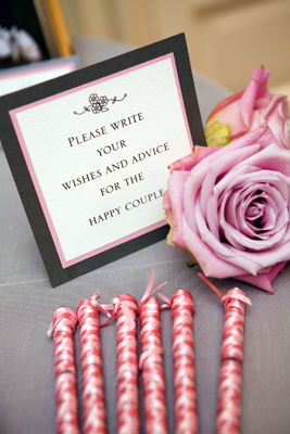 A self-standing guest book sign and our signature ribbon pens in two light shades of pink. To see more photos of this wedding, click  here.