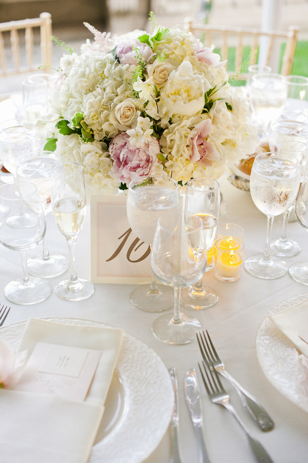 Blush Pink and Ivory make this sweet and softly romantic wedding look elegant and clean - just what the bride wanted. So see more from this wedding, please click  here .