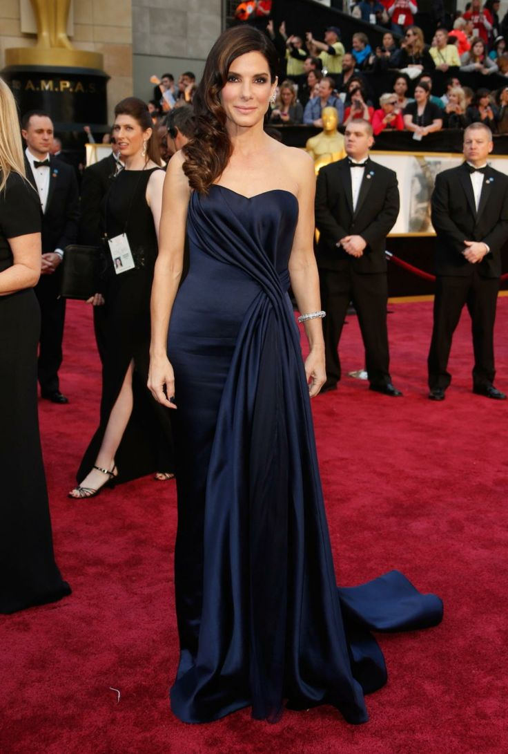Sandra Bullock's Navy Alexander McQueen dress was simple and elegant. Her hair looked perfect and we loved the adornment of   Lorraine Schwartz diamond jewelry.